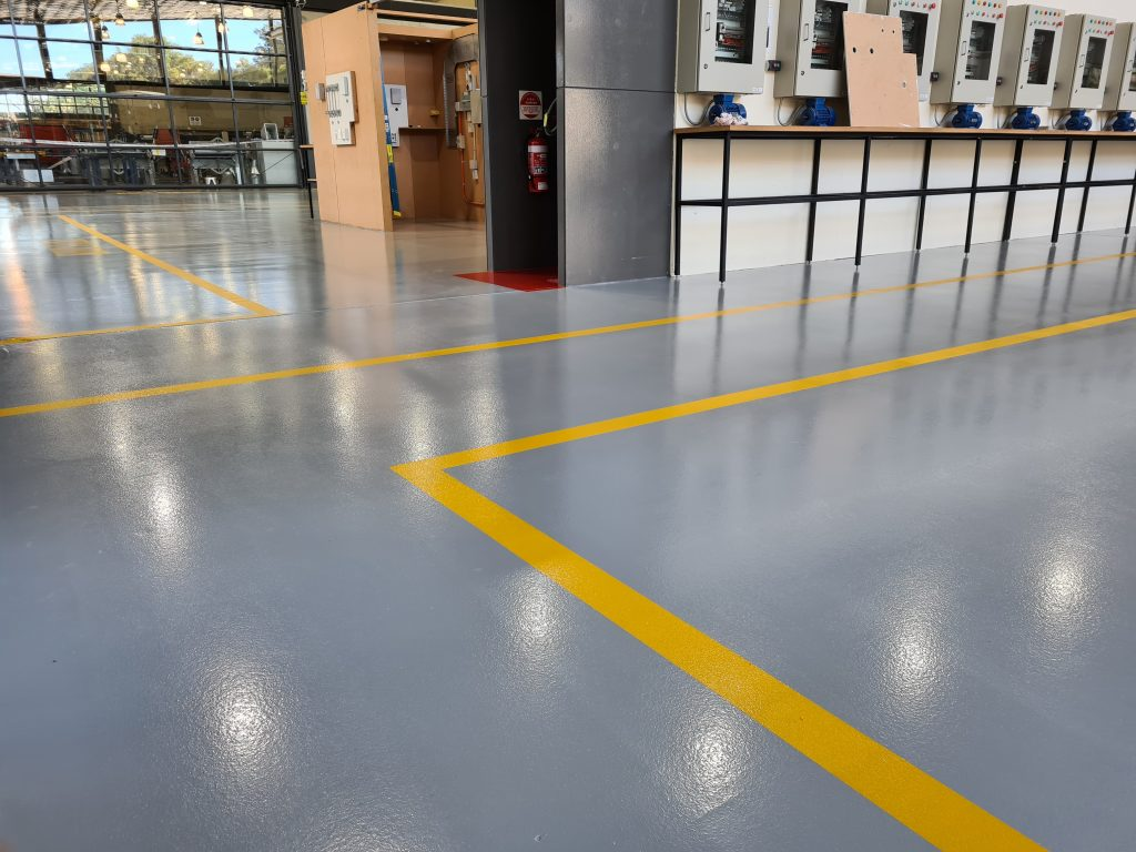 Demarcation lines on newly installed slip resistant floor at TAFE workshop