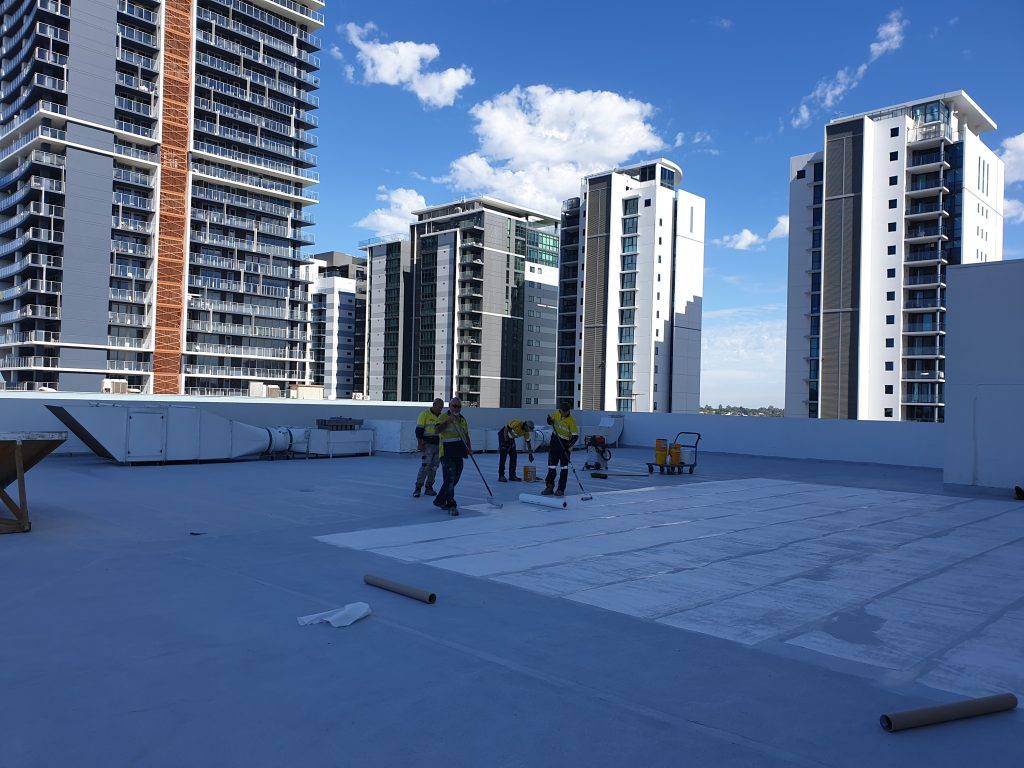 Applying the waterproofing membrane at Pan Pacific 9th Floor balcony